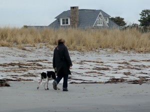 woman walking dog, Pine Point Beach, Dec 2011