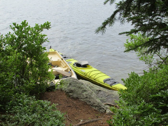 boat and kayak moored on Lake Sunapee