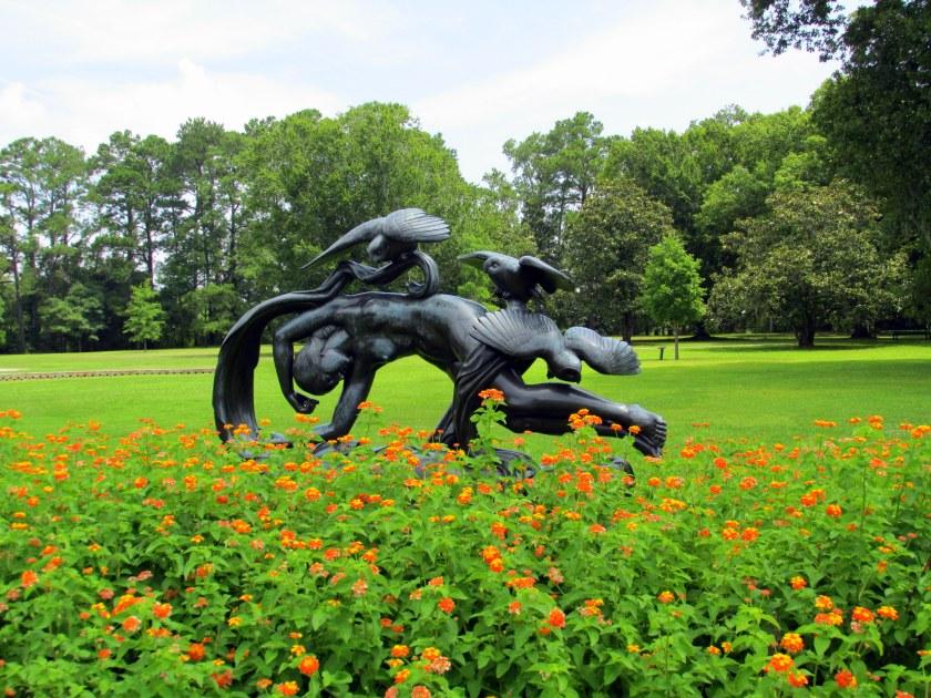 'Evening' sculpture with lantana