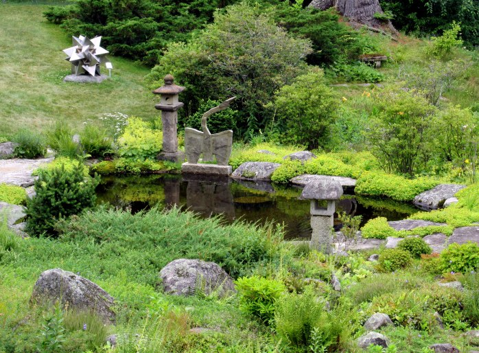 rock garden, pond, and sculpture
