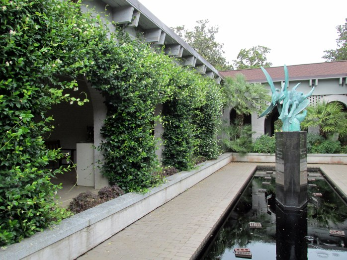 sculpture garden with jasmine vines