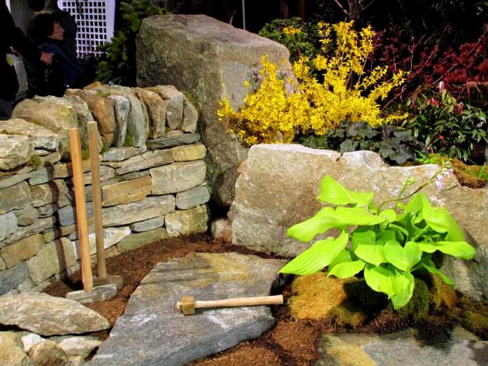 Magma Design Group display: axes, hosta, forsythia, stone wall