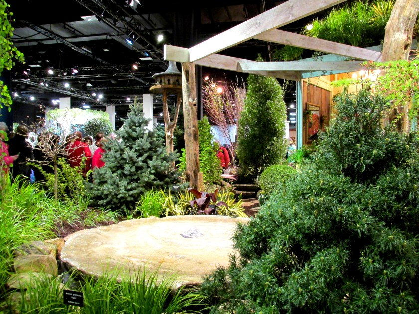 Miskovsky Landscaping and Haskell Nursery display: evergreens, structure, carex grass