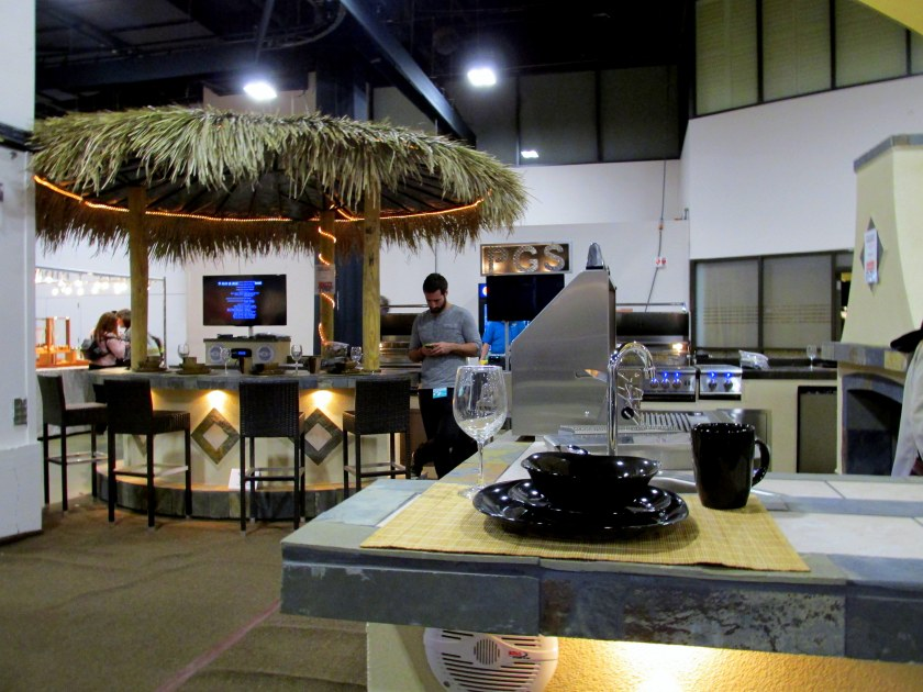 Display of large-scale stone patio kitchens and grills