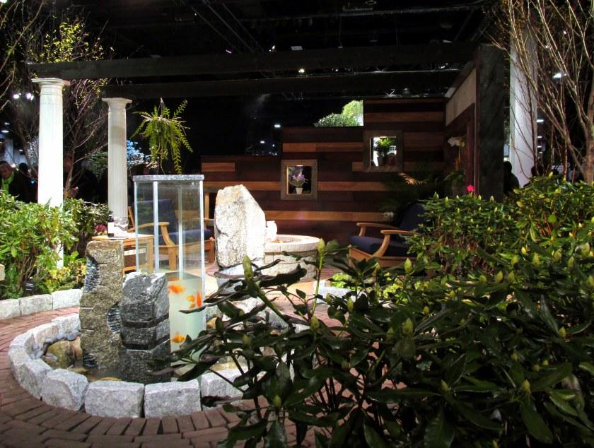 Rutland Nurseries display: patio with goldfish in vertical aquarium