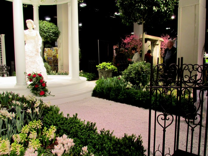 Newport Flower Show display: portico with white woman and formal garden