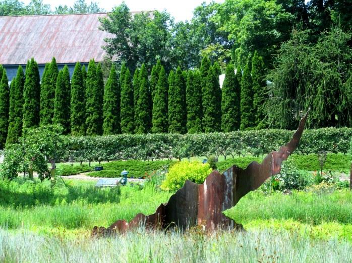 grasses, Syncopeaks sculpture, Belgian Fence of espaliered apples, arborvitae hedge