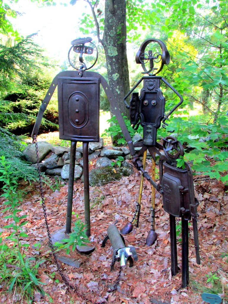 sculpture family by large pond