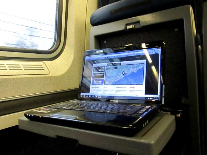 Laptop set up on Northeast Regional train, business class, Dec. 2013