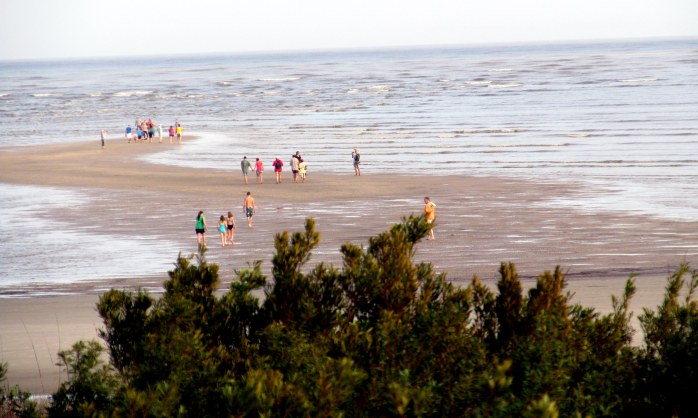people on the sand bar at low tide