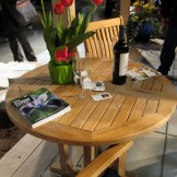 Country Teak table in Graystone Masonry display