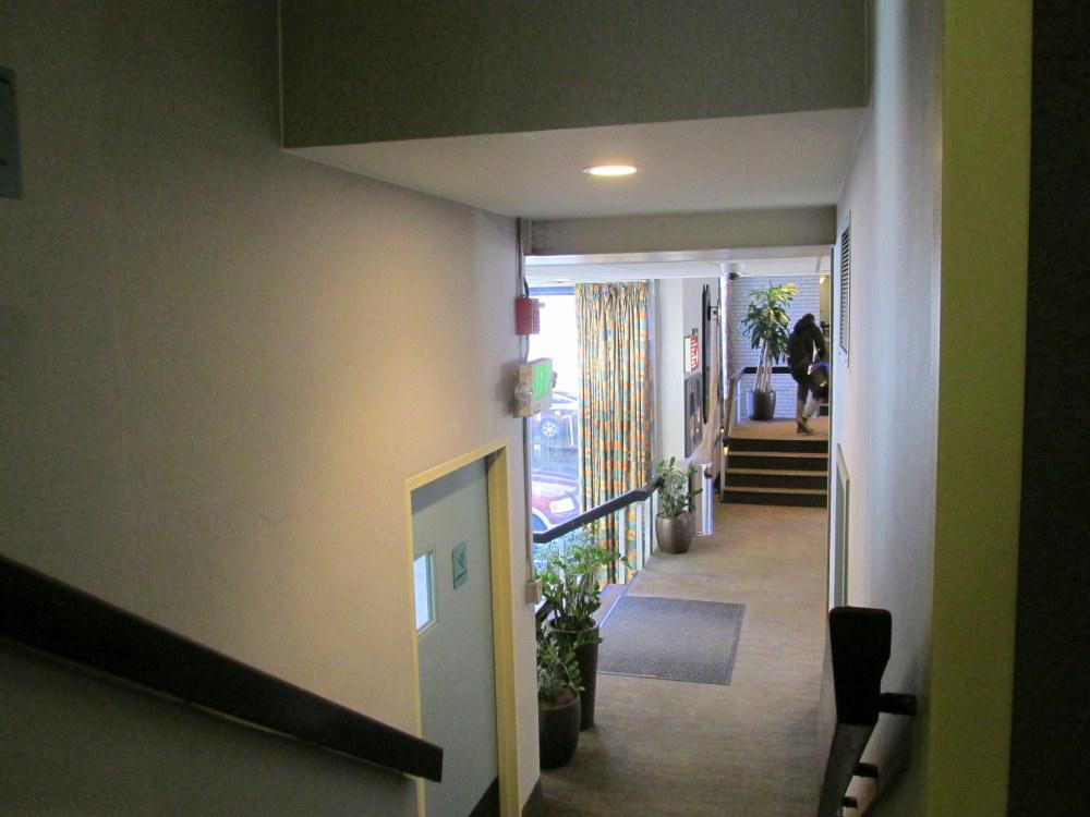 stairwayhallwaytolobbyparkinglotMidtownHotelroomBoston28Feb2015
